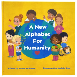 Toddler with the alphabet book