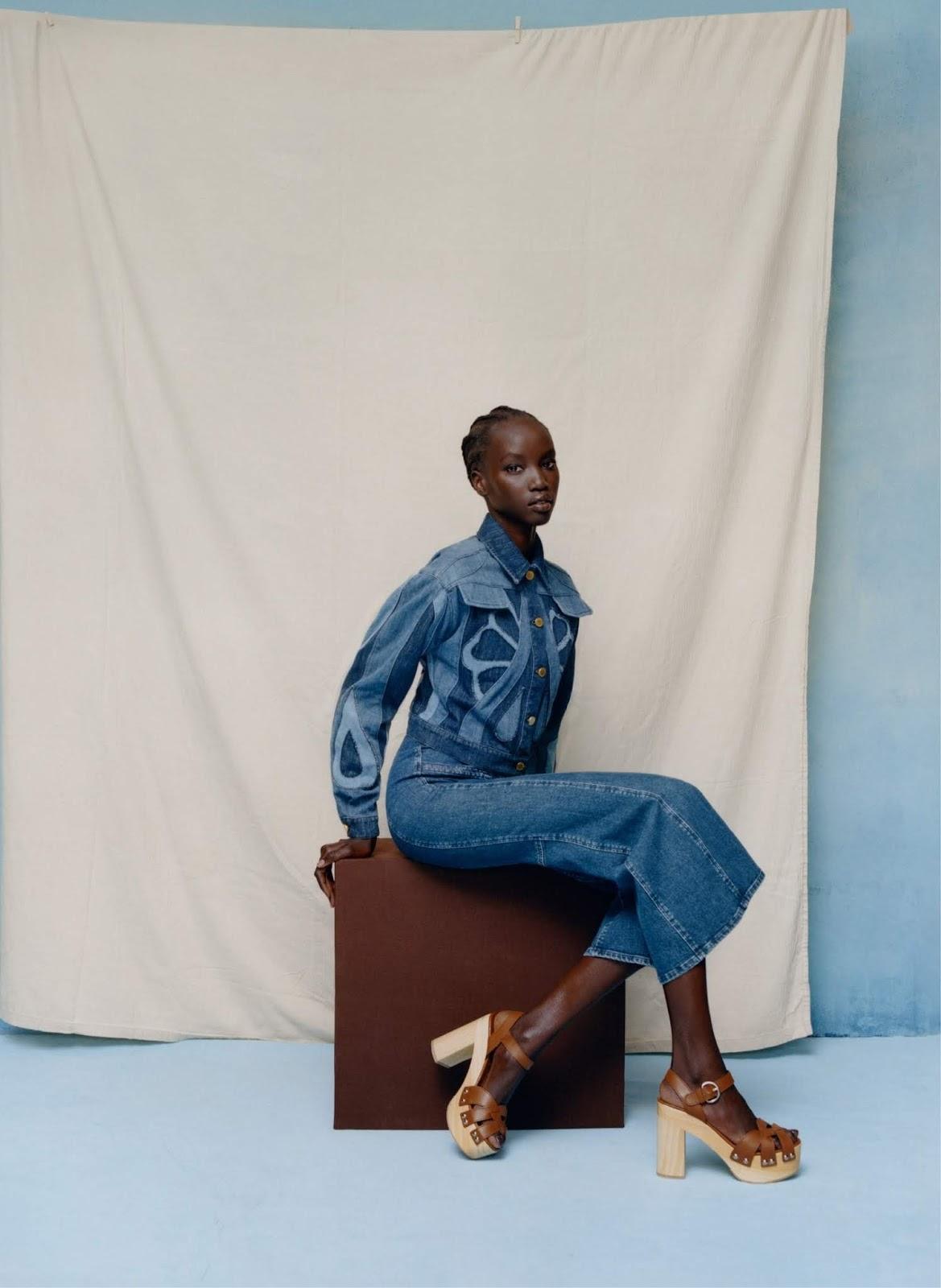 Anok Yai - Alberta Ferretti jacket and jeans. Prada sandals