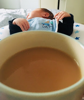 Sleeeping baby and cup of tea