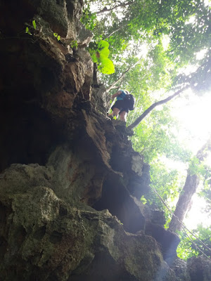 photo of a traveler climbing the cave on Koh Libong