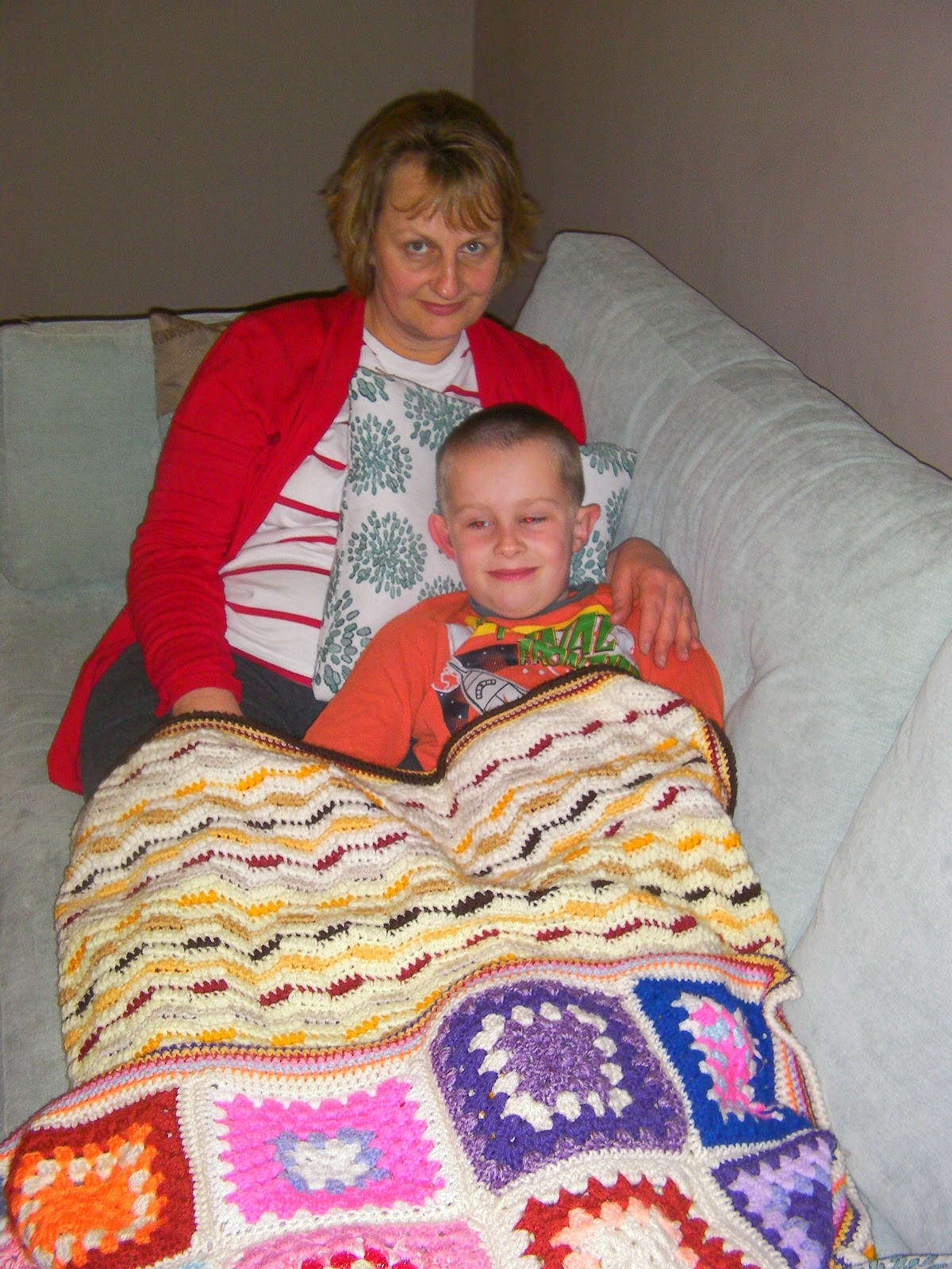 comfortable sofa with knitted blankets family happiness