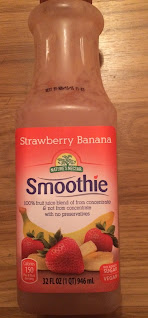 A bottle of Nature's Nectar Strawberry Banana Smoothie, from Aldi, against a wood backdrop