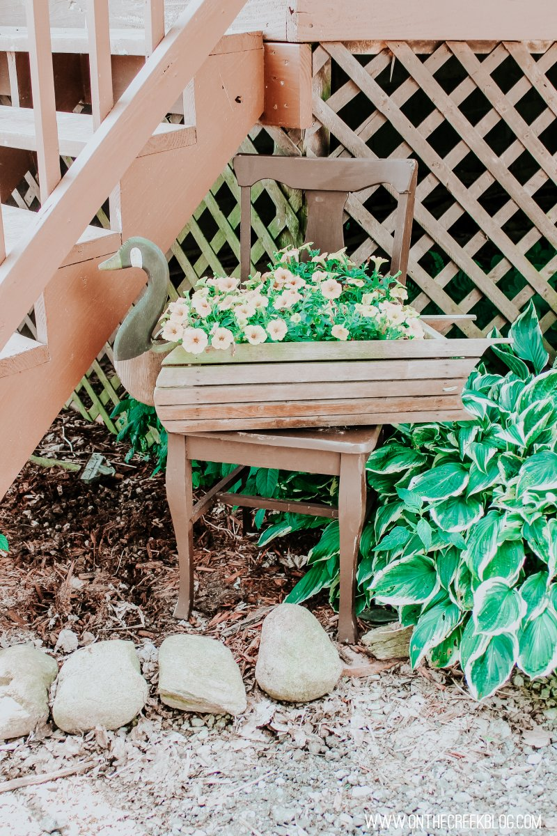Flower chair planter idea.  Goose planter on top of the chair!