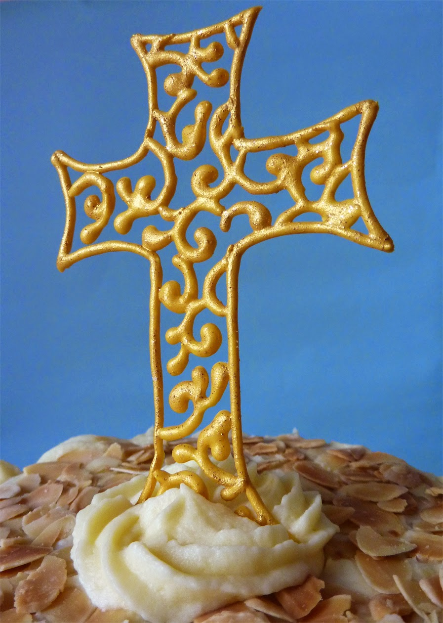 Piped royal icing filigree cross cake topper