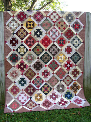 scrappy churn dash quilt from upcycled plaid shirts
