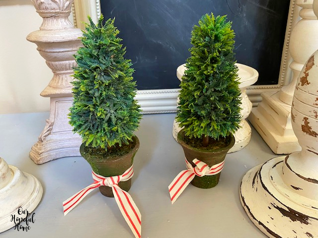 two faux French topiaries clay pots candlesticks