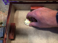 Attaching the coin to the felt