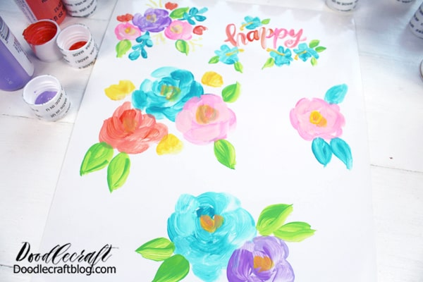 """Continue painting flowers, calligraphy, rainbows or anything your heart desires until the sticker paper is full. Leave about a 1/4"""" between image designs."""