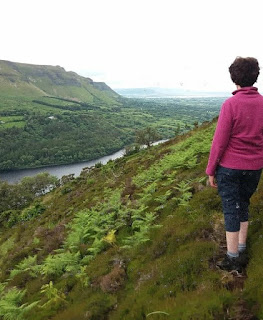 walker looking over Glencar valley and lake Leitrim