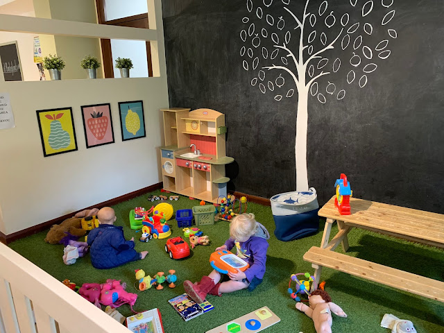 Play area in Tiptree Tearooms at Barleylands with various toys for children and a picnic bench