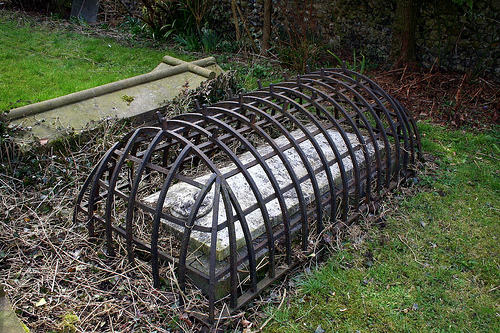 zombie grave, tombstone with cage, gothic grave
