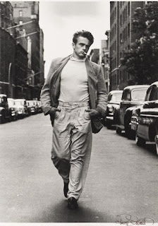 James Dean walking with a cigarette photographed by Roy Schatt