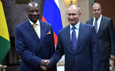 Vladimir Putin and Alpha Conde in Moscow.