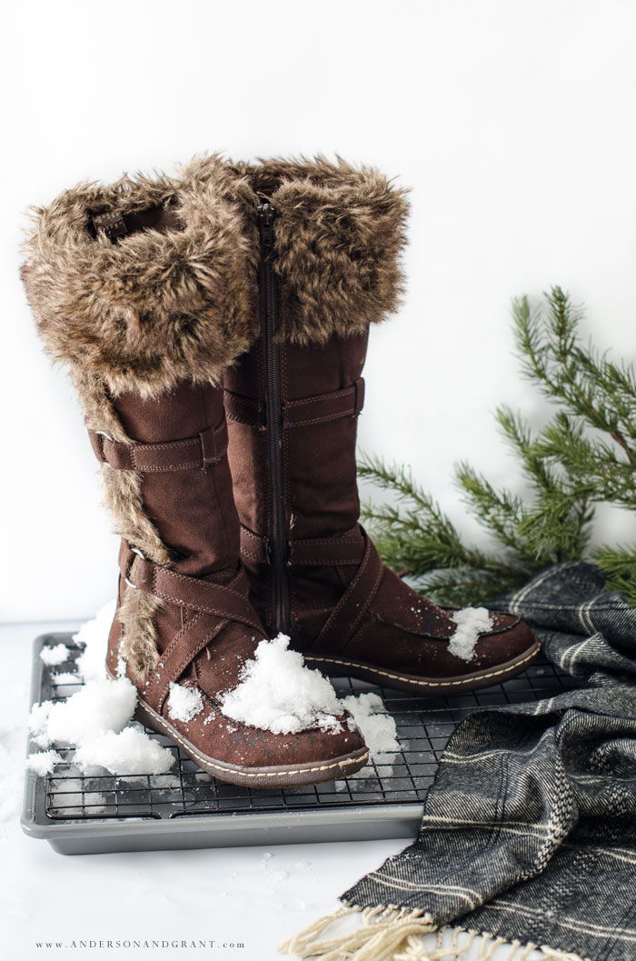 During the winter, bringing snowy boots and shoes into the house in inevitable.  But this easy project for a DIY Boot Tray will allow the boots to dry thoroughly and keep the snow and water off of your floors. #winter #organize #mudroom #andersonandgrant