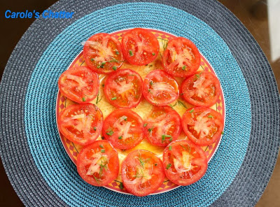 Sliced tomatoes plate with onion by Carole's Chatter