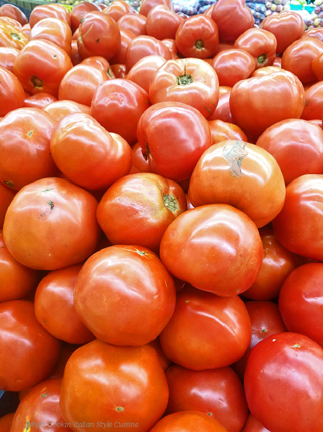 this is a bushel of beefsteak tomatoes
