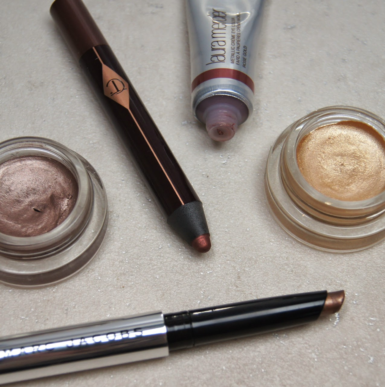 best glittery shimmery cream eyeshadows party season charlotte tilbury marc jacobs maybelline laura mercier