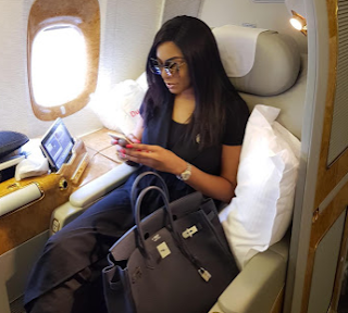Chika Ike shows off her Hermes Birkin bag in first class seat..