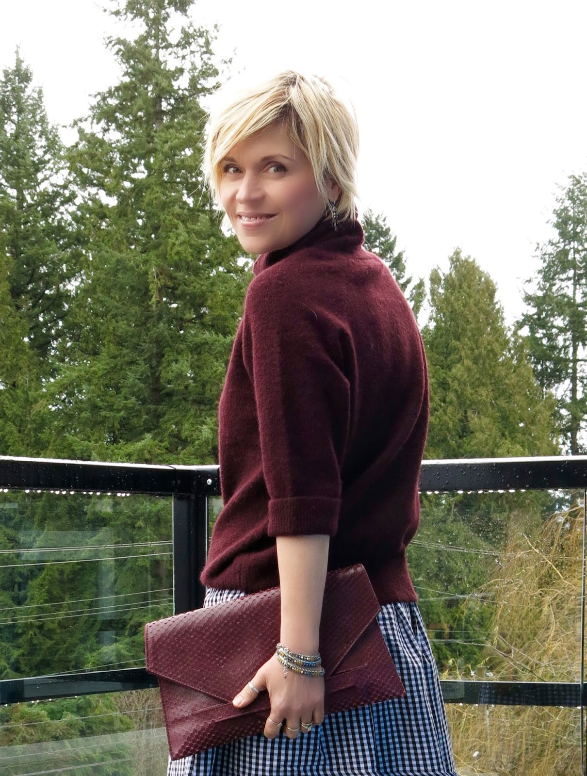maroon turtleneck, gingham skirt, faux-snake envelope clutch