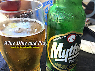 Drinking a Mythos Greek Beer on a hot summer day in Tarpon Springs, Florida at the Costas Greek restaurant