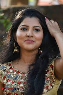 Nayana Nair Stills in Long Dress at Arasakulam Tamil Movie Audio Launch