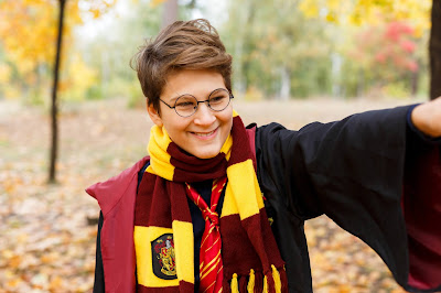 "Photo <a href=""https://www.dreamstime.com/kyiv-ukraine-october-cute-pretty-boy-costume-harry-potter-scarf-plays-as-magician-reads-book-autumn-park-cosplay-image161625020"">161625020</a> © <a href=""https://www.dreamstime.com/chekyravaa_info"" itemprop=""author"">Chekyravaa</a> - <a href=""https://www.dreamstime.com/photos-images/harry-potter-costume.html"">Dreamstime.com</a>"