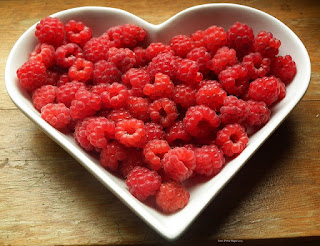 Fresh Red Raspberries in a White Heart-Shaped Bowl