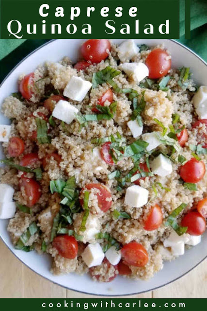 close up of salad showing textures of quinoa, basil, cheese and tomatoes