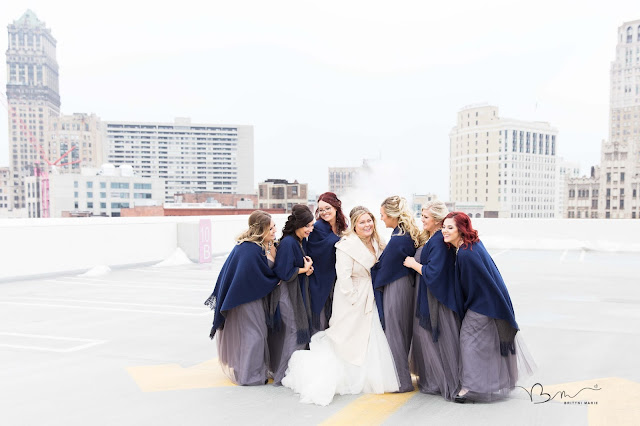 bridesmaids on rooftop at z belt lot laughing