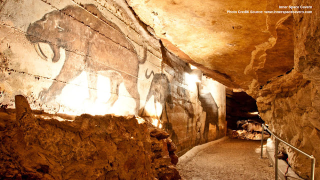 cave paintings lit up along a path