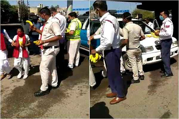 faridabad-policemen-distribute-fruits-to-poor-and-needy-people-news