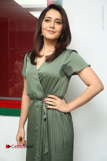 Actress Raashi Khanna Stills in Green Short Dress at Mirchi 95 Suno Aur Mercedes Jeeto Contest  0076.JPG