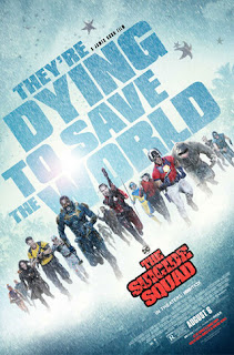 Suicide Squad poster - title in pale blue, cast members running in snow
