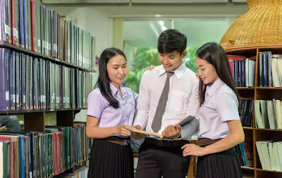 Boy and Girl Reading Books in Library