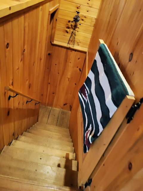 Stairs to lower level in Getaway Cabins Whispering Woods #25 cabin in the Hocking Hills