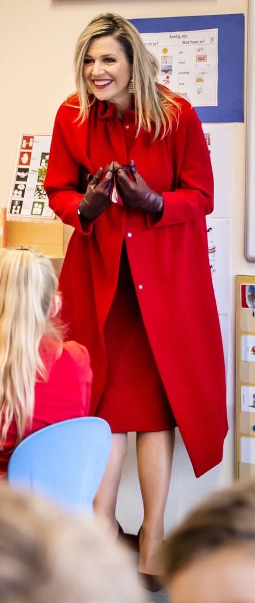 Queen Maxima of Netherlands in red Natan Coat for a school visit