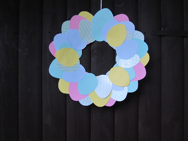 Cardboard Easter wreaths made out of egg shapes