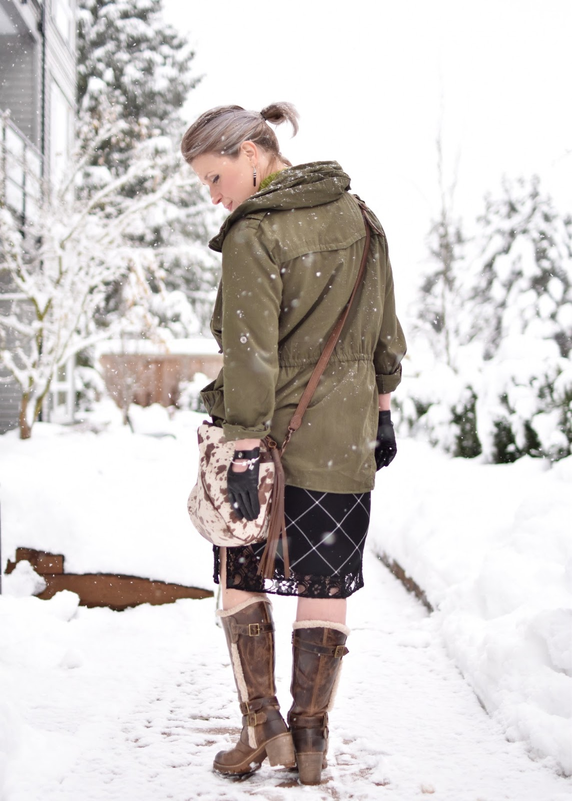 Monika Faulkner outfit inspiration - styling a plaid slipdress with an army-inspired parka, fleece-trimmed block-heeled boots, and pony-hair cross-body bag