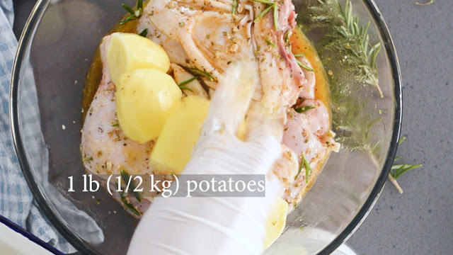 Add cut up potatoes to greek chicken