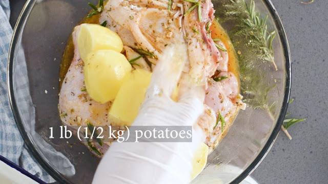 Add cut up potatoes to greek chicken