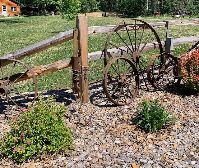 Photo of farm junk decor/split rail fence