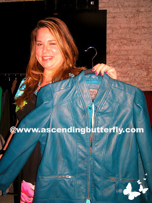 Aimee Cheshire CEO of Madison Plus holds up a Blue Jacket from MYNT 1792 at Madison Plus Select Press Preview Event at Alison Eighteen in New York City