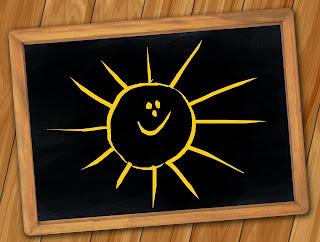 Um desenho de um sol brilhando passando uma imagem de algo positivo, de alegria.