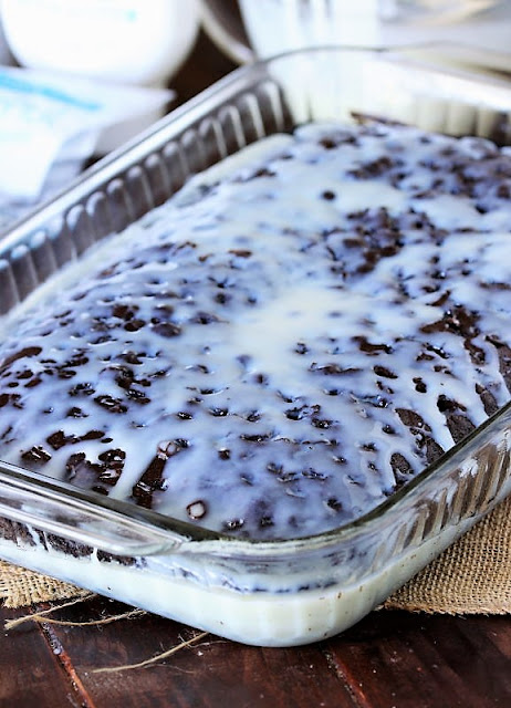 Soaking Coconut Chocolate Poke Cake with Coconut Syrup Image