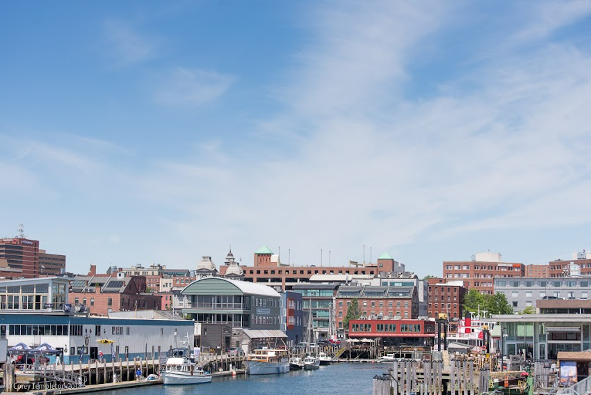 Portland, Maine USA June 2018 photo by Corey Templeton. Part of the Old Port skyline from the approach to the State Pier.