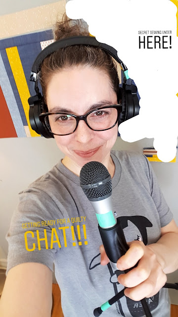 Shannon Fraser holding a mic and wearing headphones in prep for Quilt Buzz podcast interview