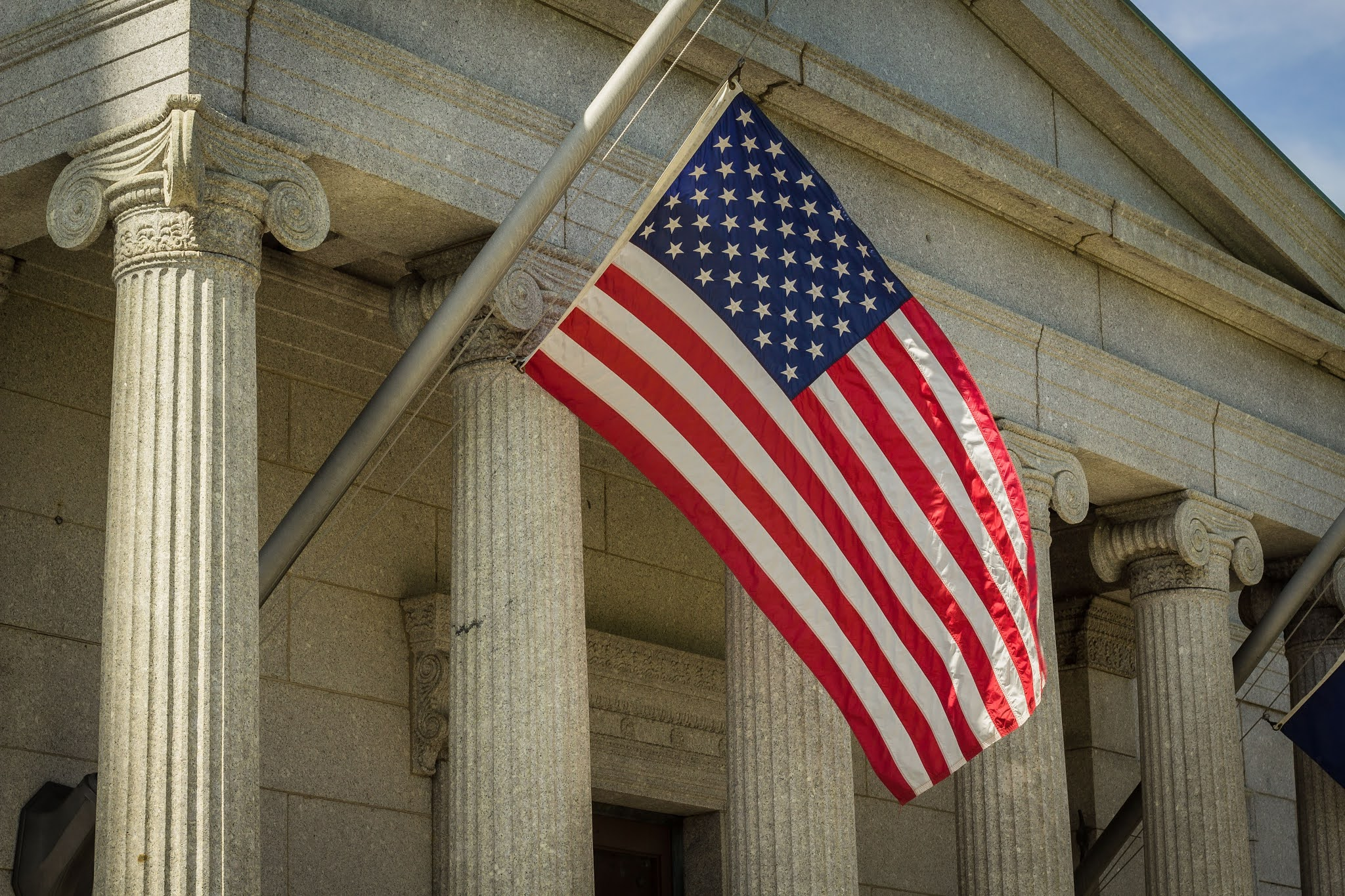 An American flag on a building in Boston CC0 image from Unsplash Bonnie Kittle