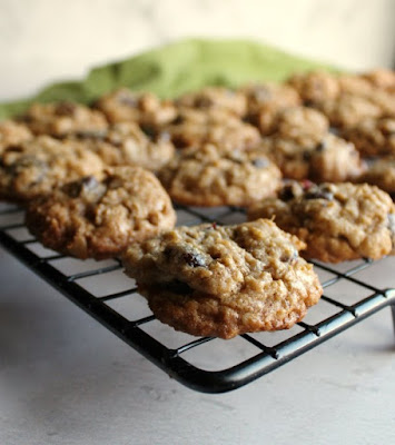 looking across a cooling rack filled with cranberry dark chocolate oatmeal cookies
