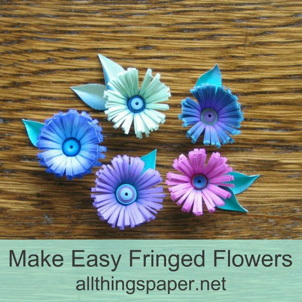 five fringed paper flowers made with bright duo-color quilling strips