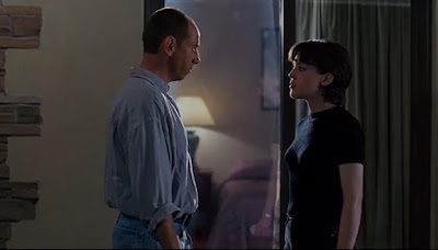 Movie still for the horror film The Night Flier where Julie Entwisle scolds Miguel Ferrer for stealing her news story